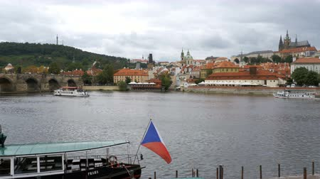 charles bridge : Panoramic view of Prague Bridge and Water Bus Boat Floating on the River Vltava Stock Footage