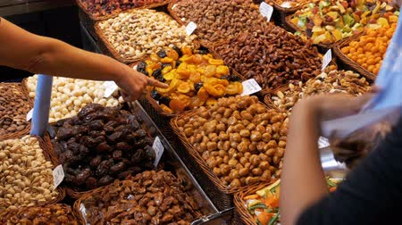 засахаренный : Large Counter of Dried Fruits and Nuts at a Farmers Market in La Boqueria. Barcelona. Spain
