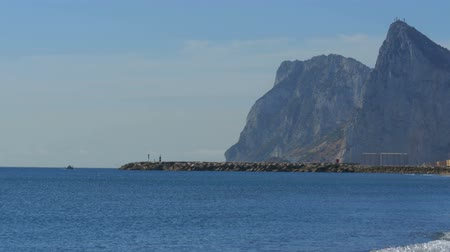 navigational : View of the Lighthouse by the Sea near the Rock of Gibraltar. Spain.
