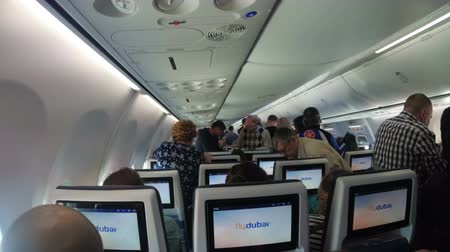 aircraft cabin : The passenger cabin with people of the airplane during take-off Stock Footage