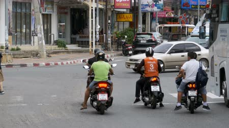 thoroughfare : Motorbikes and cars drive along Asian roads. Traffic-laden Thai streets. Thailand, Pattaya Stock Footage