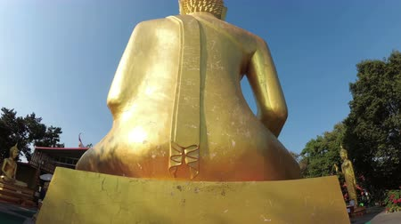steady cam : Smooth movement of the camera around the statue of the big golden Buddha. Thailand