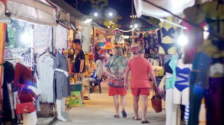 flea : People Walk at Asian Street Clothing Night Market on Jomtien Beach. Pattaya, Thailand