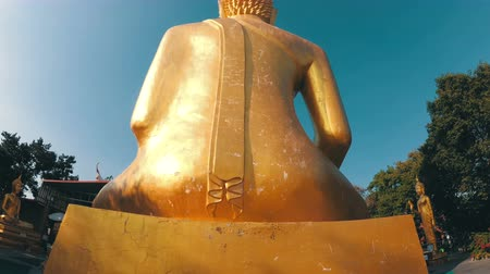 shui : Smooth movement of the camera around the statue of the big golden Buddha. Thailand