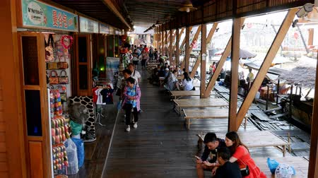 market vendor : Tourists walk on a Pattaya Floating Market. A popular place for tourists. Thailand