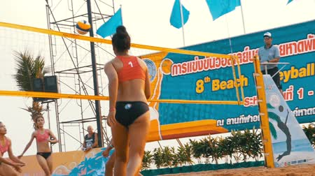 volleyball players : Womens Beach Volleyball Championship in Thailand. Slow Motion Stock Footage