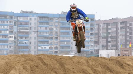 enduro : Motocross. Riders jumping. Off-road racing on enduro bikes. Slow motion Stock Footage
