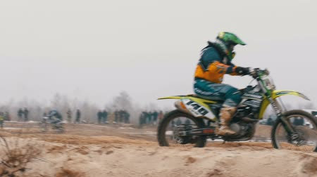 bikers : Motocross. Off-road racing on enduro bikes. Slow motion