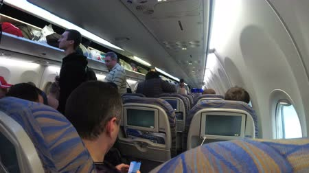 attendant : The passenger cabin with people of the airplane during take-off Stock Footage
