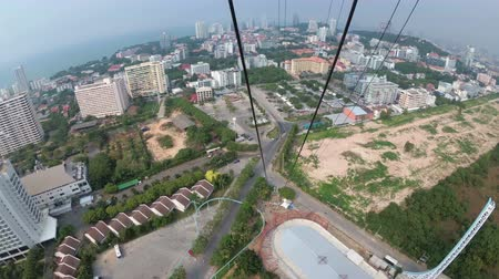 zipline : First person view of a man goes down on the cable from the roof on the Pattaya City Tower