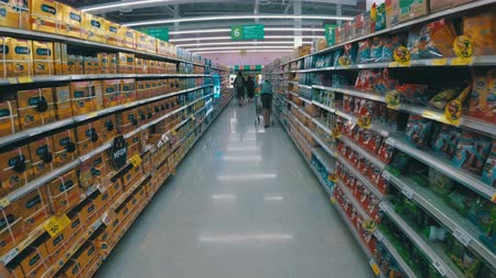 necessidade : Shelves with goods in supermarket. Grocery shopping from view of a shopping cart. Thailand.