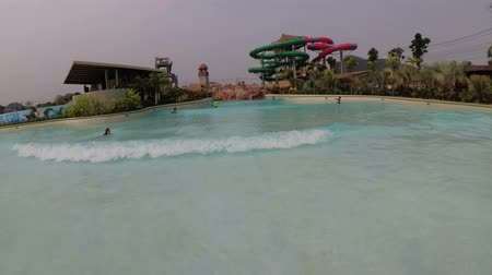 waterslide : Pool with artificial wave in the Aqua Park of the Ramayana. Thailand