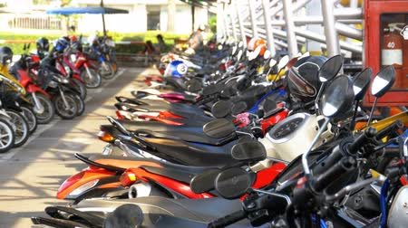 people shopping : Motorbike on the Parking in Thailand near the Shopping Center Stock Footage