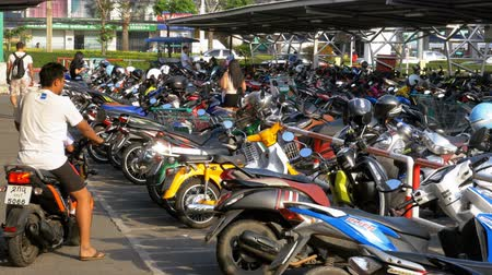 europe population : Motorbike on the Parking in Thailand near the Shopping Center Stock Footage