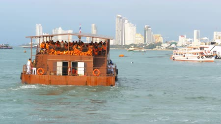 vest : Ferry with Chinese tourists in orange life jackets on board the rusty vessel. Thailand