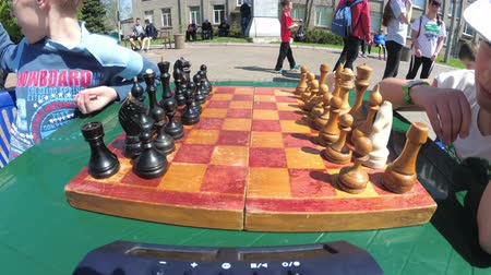 пешка : Chessboard and figures. Competitions in checkers among children