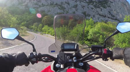 first born : Motorcyclist Rides on the Scenic Mountain Road on Serpentine in the Mountains
