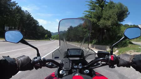 toward : Motorcyclist Rides on the Scenic Mountain Road on Serpentine in the Mountains
