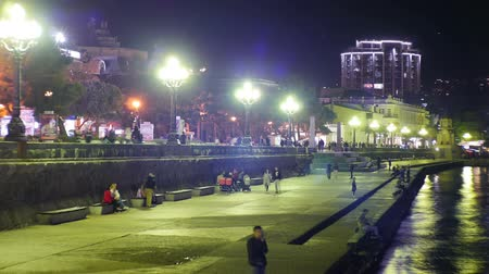 crowds of people : Night Embankment of Yalta, Crimea. TimeLapse Stock Footage