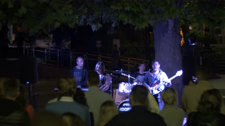 rock festival : Street rock band plays guitars, drums and sing songs at night Stock Footage
