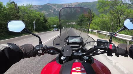 serpentine : Motorcyclist Rides on the Scenic Mountain Road on Serpentine in the Mountains