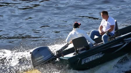 motorbot : People on a fast motor boat are Sailing along the river in Slow Motion