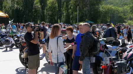 press conference : Journalists with a camera and a microphone are interviewed at the Tarasova Mountain Moto Festival