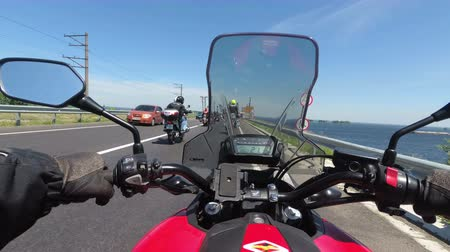 brake : Chest view on the helm of motorcycle riding in a column of bikers on the road