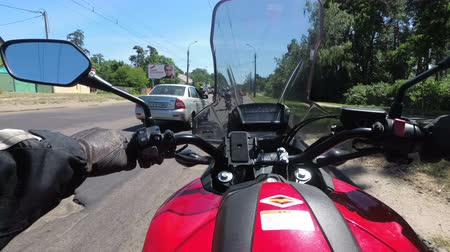 first person : Chest view on the helm of motorcycle riding in a column of bikers on the road