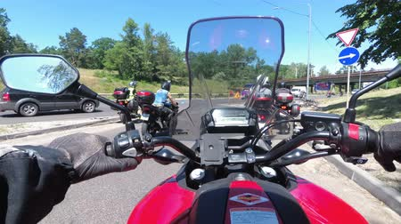 drive through : Chest view on the helm of motorcycle riding in a column of bikers on the road