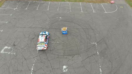 canto : Top view of a Rally Car Performing Drift on the Asphalt