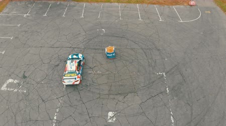 opencast : Top view of a Rally Car Performing Drift on the Asphalt