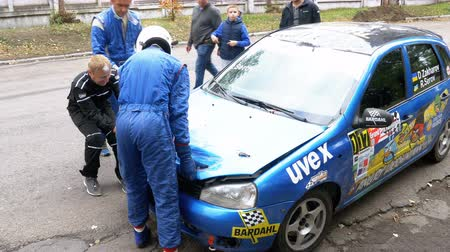 crashed : The spectators help to turn over the rally car on the roof. Accident with Rally car