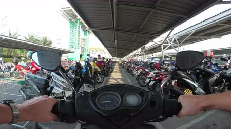 Riding Motorbike on the Parking in Thailand near the Shopping Center