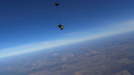 Parachutists Jumping in Tandem out of an Airplane Stock Footage