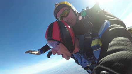 padák : Skydivers Jumping in Tandem out of an Airplane. Slow Motion