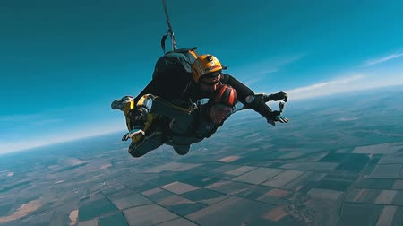 Tandem Skydiving. The moment of opening the parachute. Tandem Jump. Free Fall