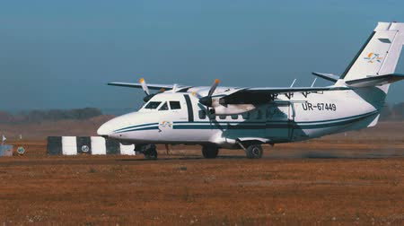 Small Twin-Engine Airplane moves along the Runway with a Ground Cover Stock Footage