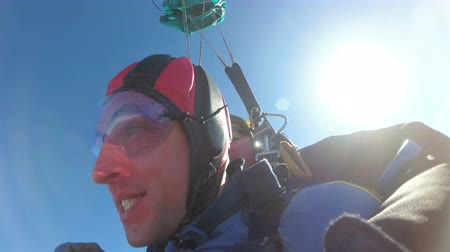 Tandem Skydiving. Tandem Jump. Parachutists in Long Free Fall. Slow Motion