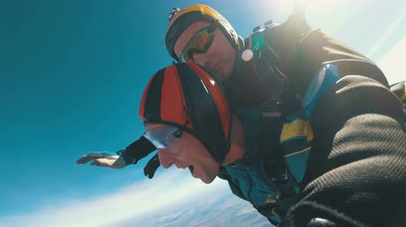 padák : Parachutists Jumping in Tandem out of an Airplane. Slow Motion