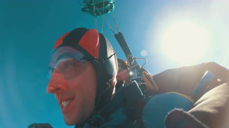 Tandem Skydiving. The moment of opening the parachute. Tandem Jump. Free Fall. Slow Motion Stock mozgókép