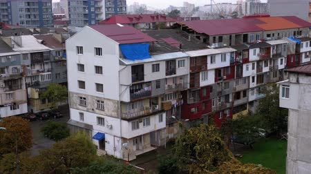 Panoramic view of the old and new high-rise buildings of the city Stock mozgókép