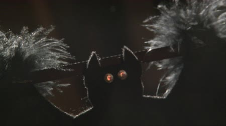 hibernation : textile bat halloween garland decoration moving in the wind under rays
