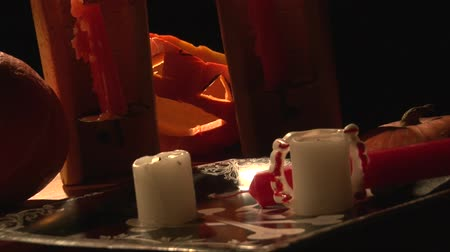 sharpened : Vampire table with bloody teeth, candles, candlesticks and scary Jack O Lantern pumpkin, halloween party, live cam Stock Footage