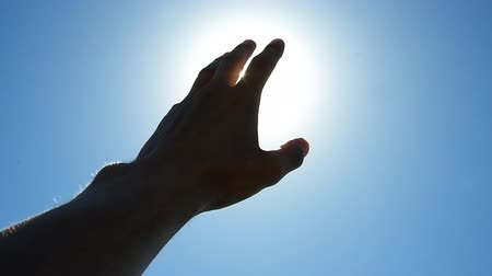 god ray : Hand of man strive to sun and deep blue sky. Conceptual scene.