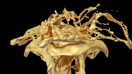 złoto : Gold Colored Splash In Slow Motion Wideo