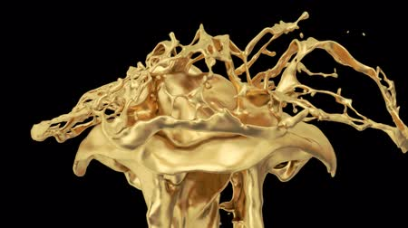 elszigetelt fekete : Gold Colored Splash In Slow Motion Stock mozgókép