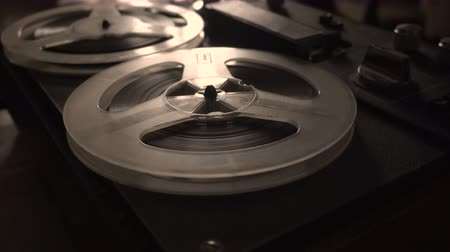 compact disc : Old tape recorder is playing music, close up