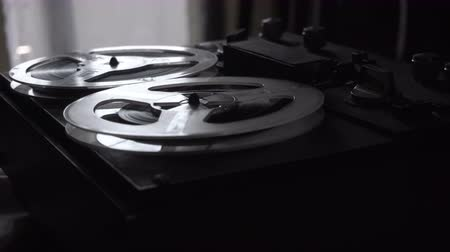 kompakt : Old tape recorder is playing music, close up