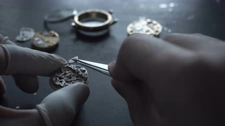 detail : Watch maker is repairing a vintage automatic watch. Stock Footage